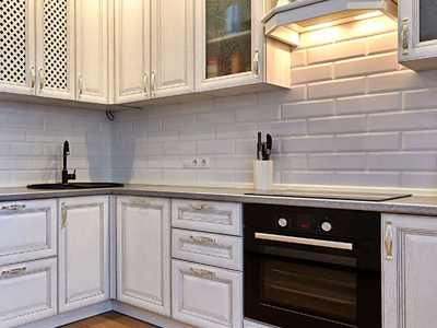 white brick kitchen backsplash and cabinets